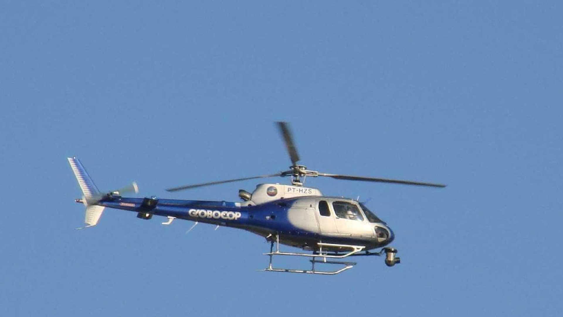 Helicóptero da Globo cai em praia e deixa ao menos 2 mortos